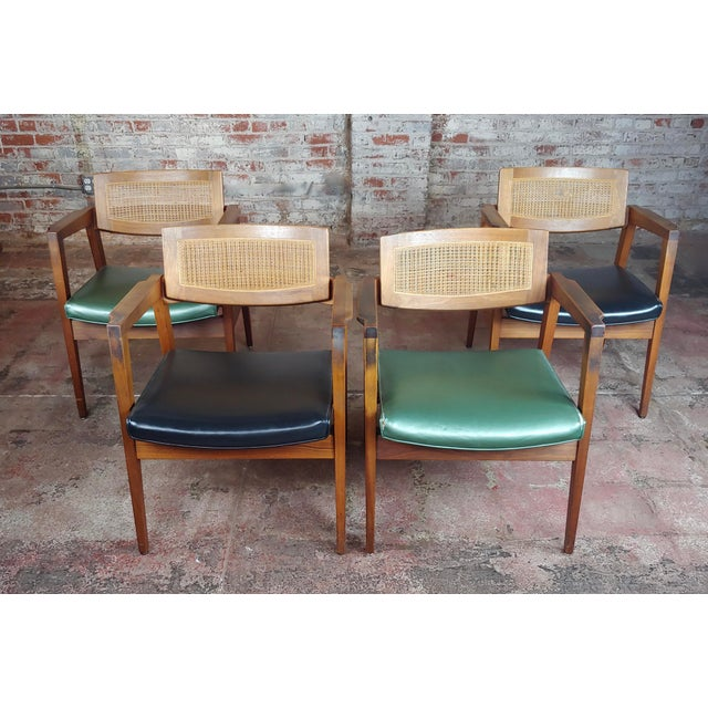 "Gunlocke 1960s Mid Century Modern Cane Back Arm Chairs -Set of 4 size 24 x 20 x 31"" seat height 17"" A beautiful piece that..."