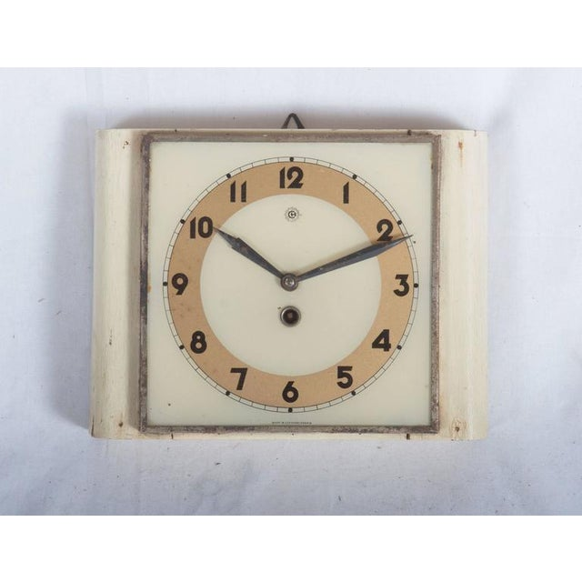 This clock made from bended plywood with a glass clock was made in the 1930s by Chomutov (later part of the Kienzle...