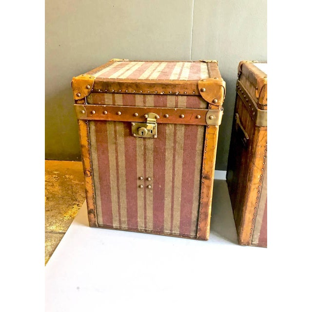 It is a highly unusual to find a pair of matched of early 20th century, French canvas and leather Hat Trunks. The wide-...