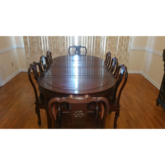 This is a lovely Chinese Antique Rosewood Dining Table with 8 matching chairs. It is made from solid rosewood with...