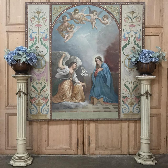 19th Century Grand Oil Painting on Canvas of the Annunciation is a brilliant work by an anonymous artist depicting the...