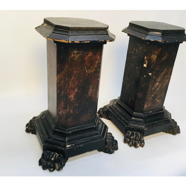 Pair of 18th century or even earlier carved , and painted pedestals . Rectangular columns sitting on lions feet . Possibly...