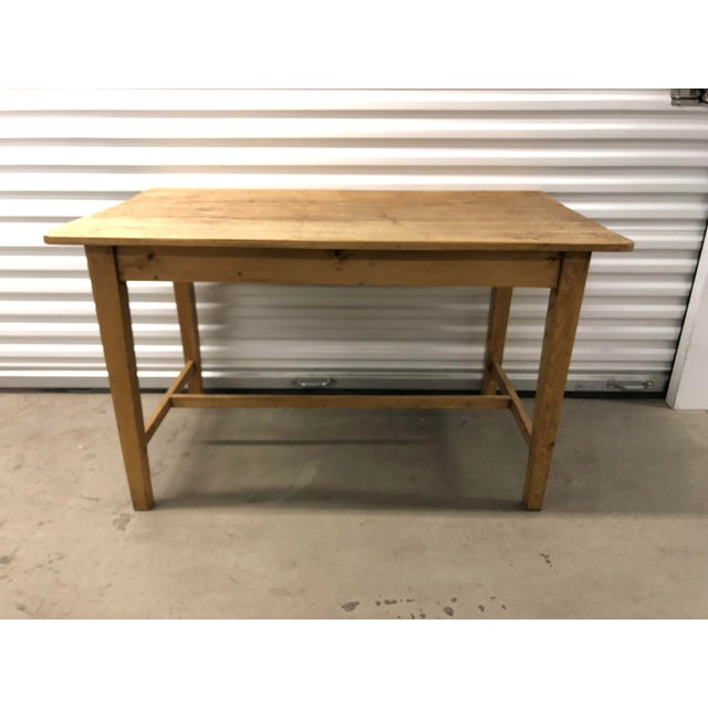 Light wood side table has beautiful graining and would be a great addition to any house. Made in the 1960s.