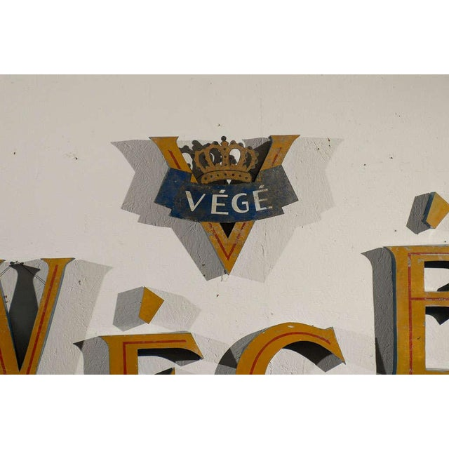 A Belgian tole vintage free mounted wall shop sign. This Végé metal shop sign can be mounted individually to taste. It...