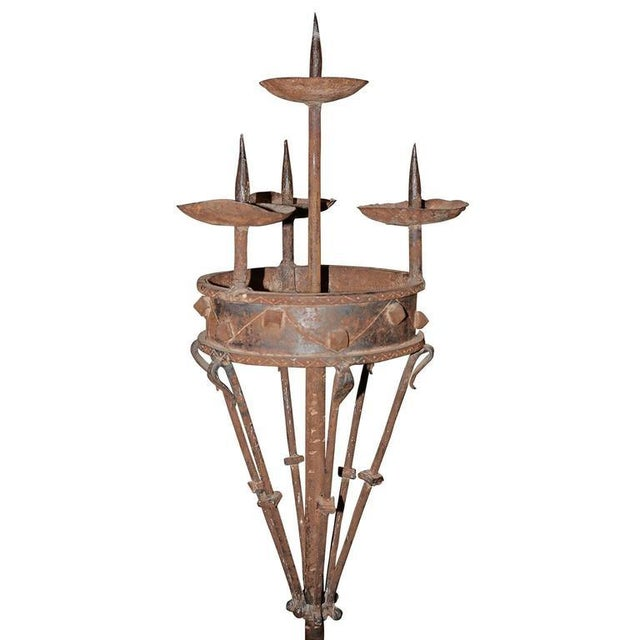 Pair of tall and sleek handmade forged iron candleholders. The patina on this pair is amazing. The iron rotating candle...