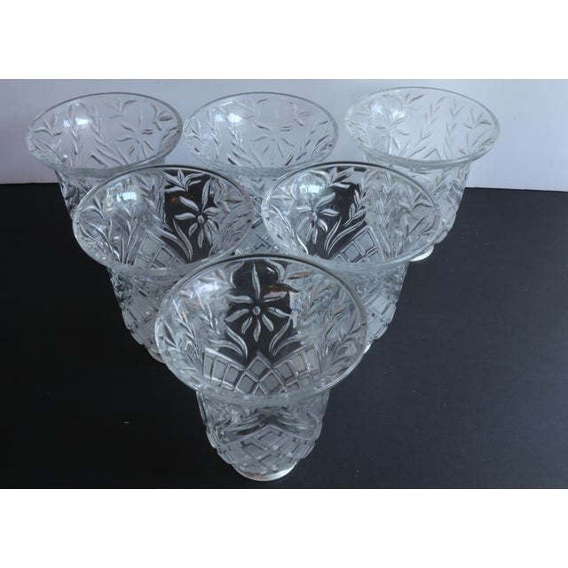 Beautiful cut glass light covers are in excellent vintage condition. Glass is clear. This is a set of sic pieces sold...