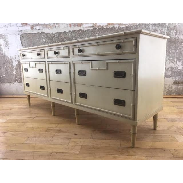 Available is a beautiful vintage faux bamboo Ficks Reed 9 drawer dresser/credenza with original hardware. We are a Raleigh...