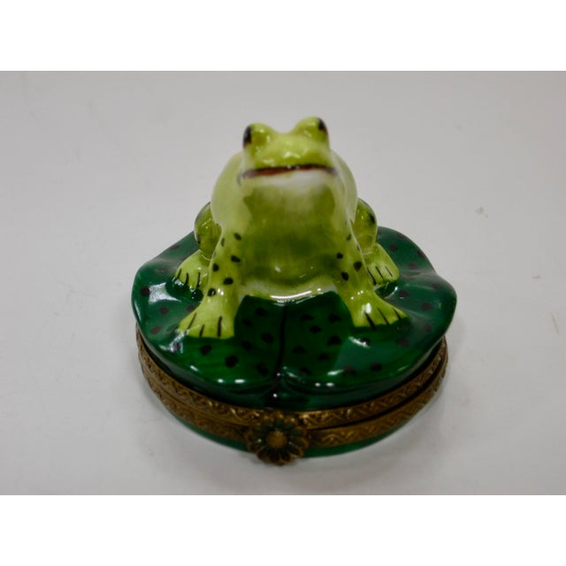 Limoges France hand painted smiling sitting frog on a lily pad . A great collectors piece in colors ranging from light...