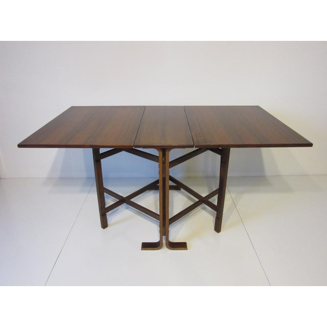 A dark and richly grained Brazilian rosewood folding gate leg dining table great for that smaller space , made in Norway ....