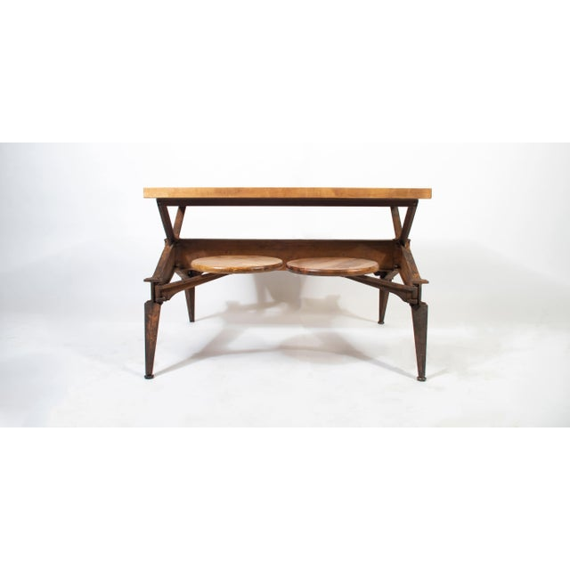 """This swing stool dining table features a solid cast iron base and four swing arms. The tabletop is 1.75"""" thick maple..."""