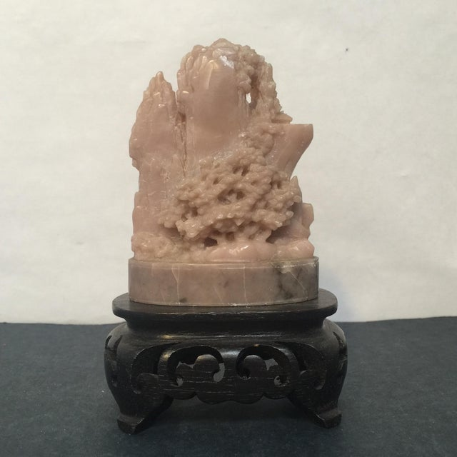 This lovely mountain scene is carved in soapstone and comes on a black wood display stand. Really beautiful and well done....