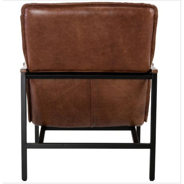 Mid Century styling is back with a passion. Lounge in the comfort and style of this handsome accent chair featuring top...
