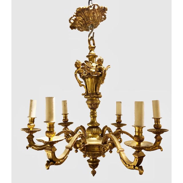 A pair of French Regence' Style Chandeliers related to Andre Charles Boulle with original canopies. Circa early 20th...