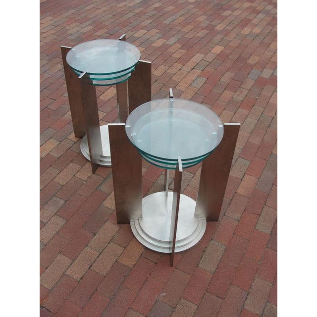 These beautiful tables are exceptionally crafted and extremely heavy. Made of solid brushed steel and glass. Approx....