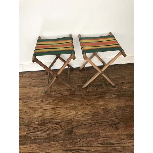 These darling striped folding camping stools would make an excellent addition to any space. They have lived a full life...