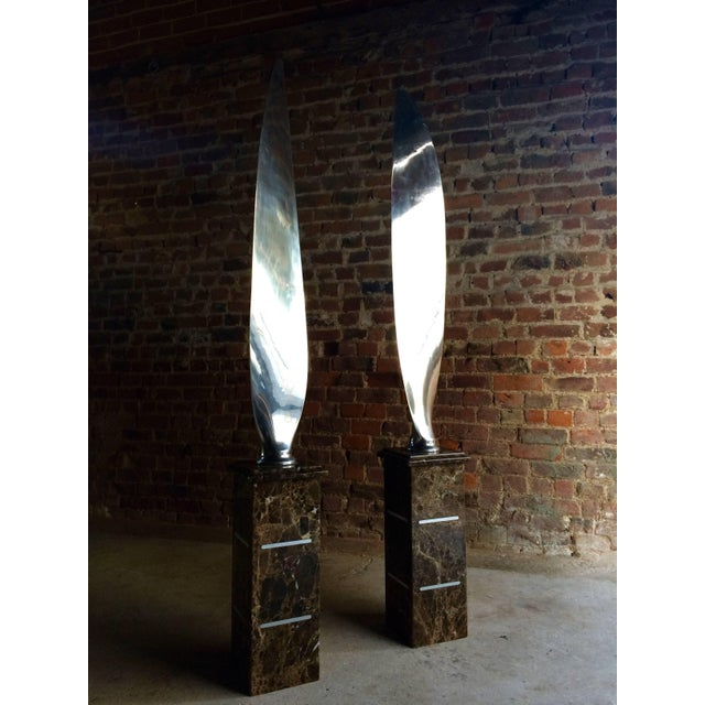 A stunningly beautiful unique and one of a kind pair of chrome Airplane Propeller Blades, each highly polished to mirror...