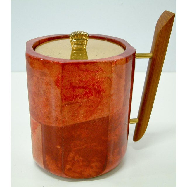 Italy Circa 1950 A stunning red-dyed parchment lidded ice bucket with walnut handle, brass finial and glass insulated liner.