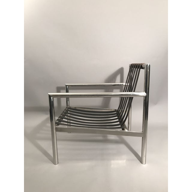 Beautifully constructed polished stainless steel chair with leather straps by Albert Herbert for Eppinger Furniture Co....