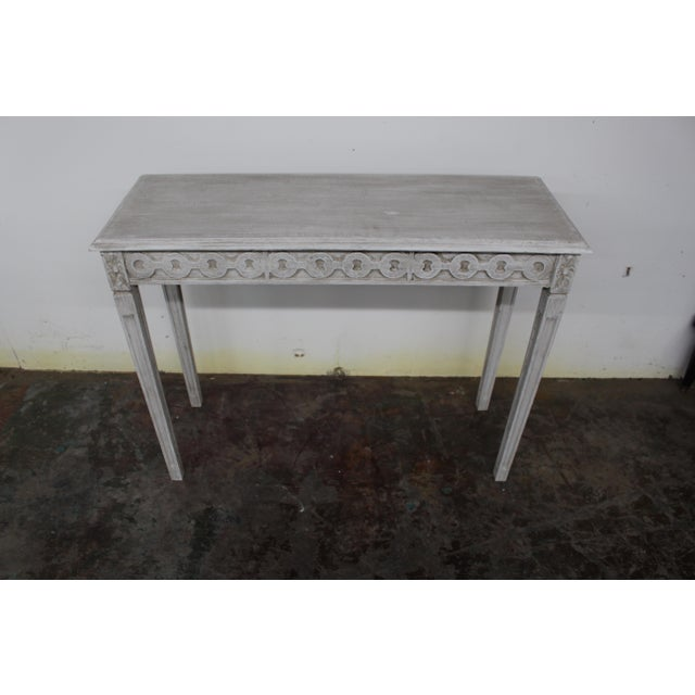 Vintage French console made of solid oak and newly refinished with an antiqued, distressed gray wash. Highly functional in...