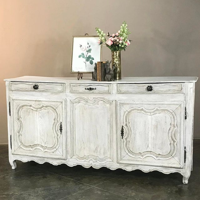 18th Century Country French Whitewashed Buffet features a whitewashed finish, giving it a wonderful patina over the...