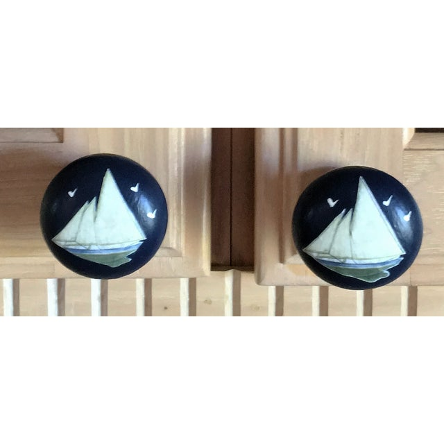 Hand painted decoupage knobs for furniture or cabinets. Hardwood knobs are painted with multi colors in two coats and...