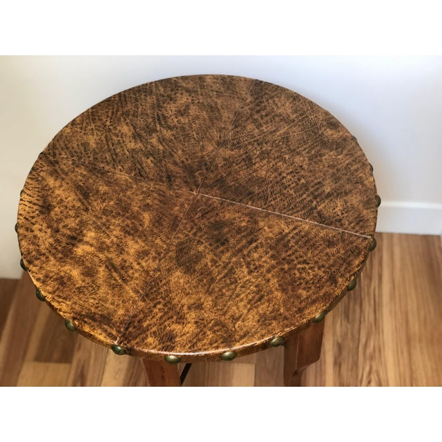 Gorgeous side or accent table with leather top. Made of solid wood with wrought iron accents. Would look beautiful paired...