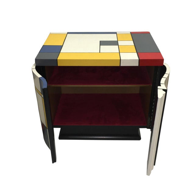 Playful pair of multi color lacquered nightstands. Inspired by the paintings of Mondrian these nightstands add color to...