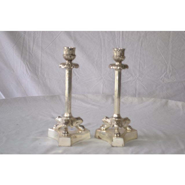 Vintage pair of classic traditional silver plated fluted candlesticks with claw feet. These are in good condition.