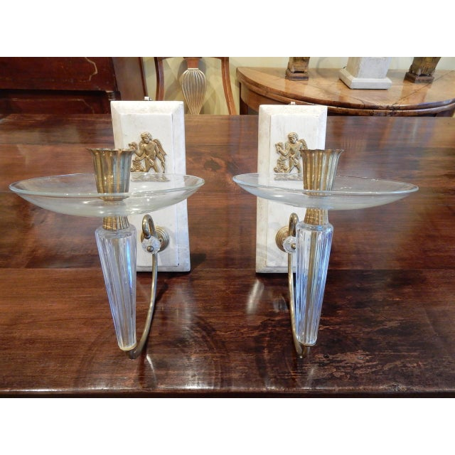 Pair of 1930's French Art Deco glass, brass and painted wood wall sconces.