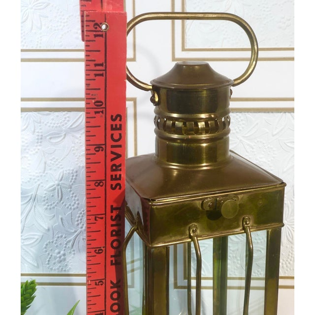 This is for a wonderful older Solid Brass Oil Lamp that has a maritime feel. It has very thick glass on the caged sides...