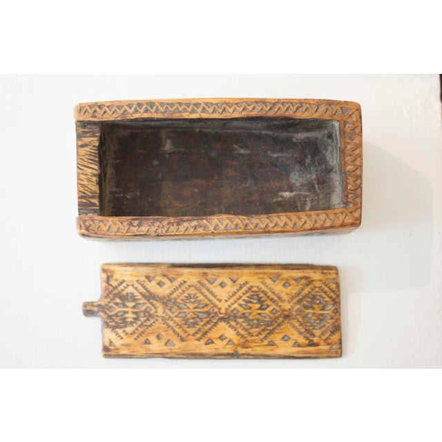 Moroccan hand carved wooden box with removable top.