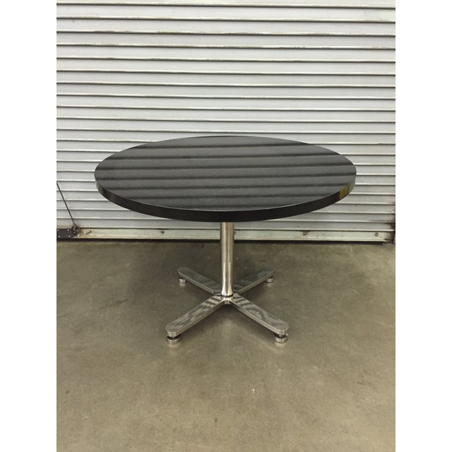 This solid granite and stainless steel table by famed New York industrial furniture designer Brueton is a beast when it...