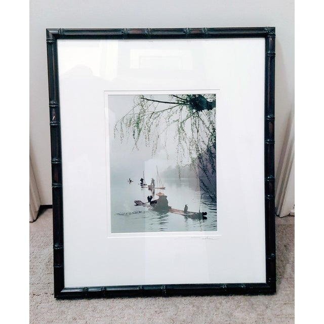 This signed photographic print captures the serenity that is found by the fisherman on rustic reed fishing vessels in...
