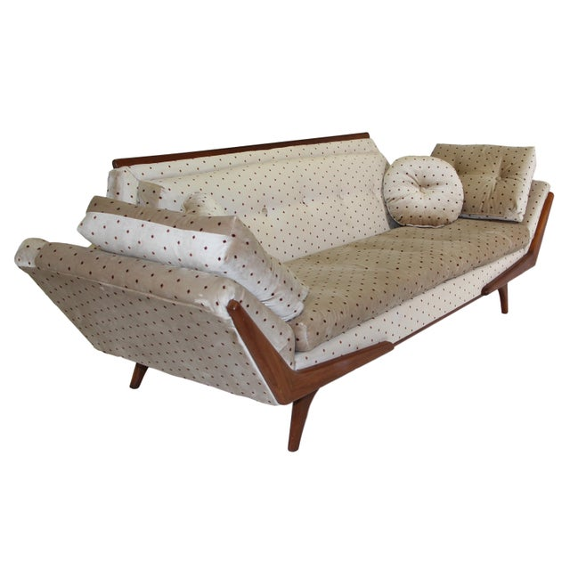 Beautiful gondola style sofa in the style of Adrian Pearsall made by Rowe. Sofa has been re-upholstered with a cream...
