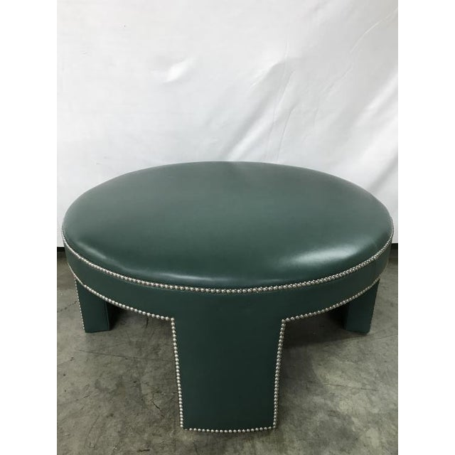 The Durant Large Ottoman is a first quality market sample that features a Green Leather with Smooth Round Chrome Nailheads.