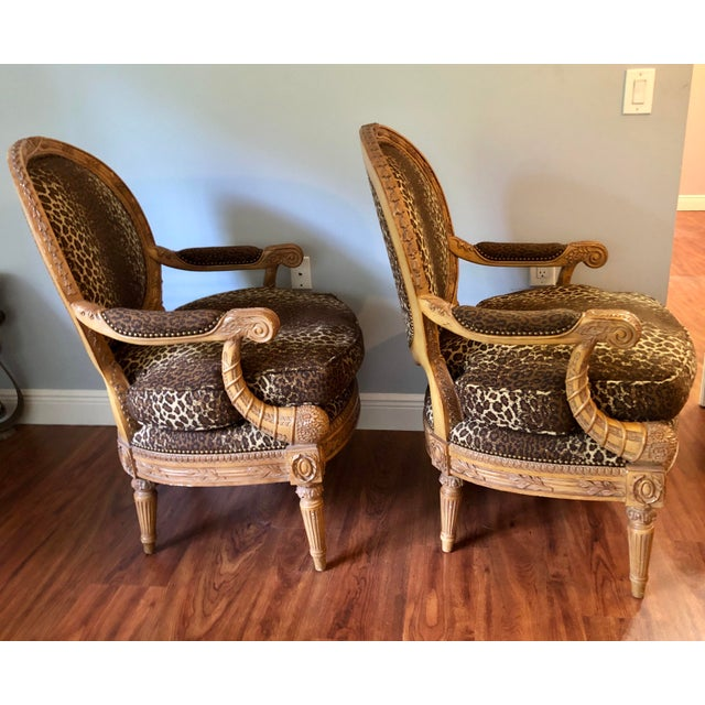 This is a lovely pair of Maitland Smith hand carved chairs for Indonesia. Custom upholstered in a cheetah print.