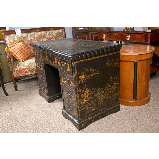 Chinoiserie knee hole desk decorated with an all-over, 18th-Century-style, gold Chinoiserie design. Decorated bracket feet...