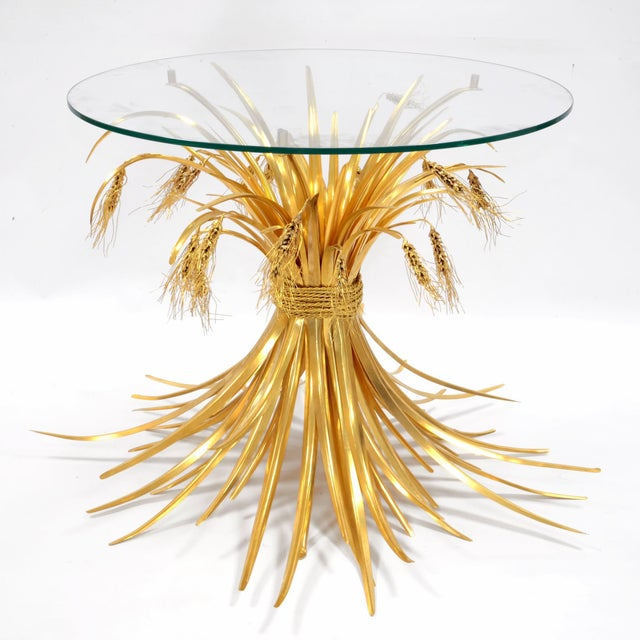 Robert Goossens (1927-2016) Rye table Gilded bronze, glass France, circa 1970's This table was made for Yves Saint-Laurent...