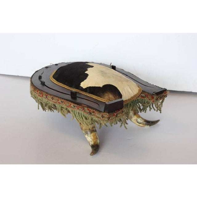 Antique American Folk Art cowhide and horn foot stool. Wood look great in a country style home.