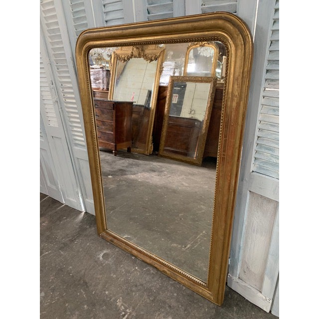 Grand French Louis Philippe mirror beautifully showcases the classic details of any Louis Philippe frame. It holds a tall,...