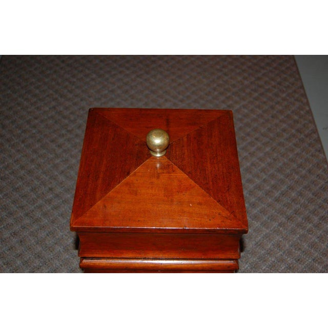 19th century tall storage box thought to have stored spirits (as in the kind you drink).