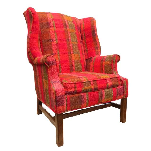 Classic Georgian style wingback chair by Flexsteel. Draped in beautiful deep red plaid wool. Dark oak legs with...