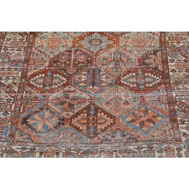 Gorgeous all wool, hand-made Persian bakhtiari rug. Age is circa early 19th century. This rug was dyed with only vegetable...