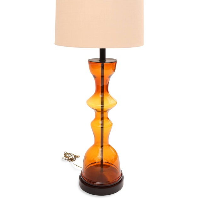 Wayne Husted for Blenko blown glass table lamp, circa late 1960s. This large-scale example has hues of yellows oranges and...