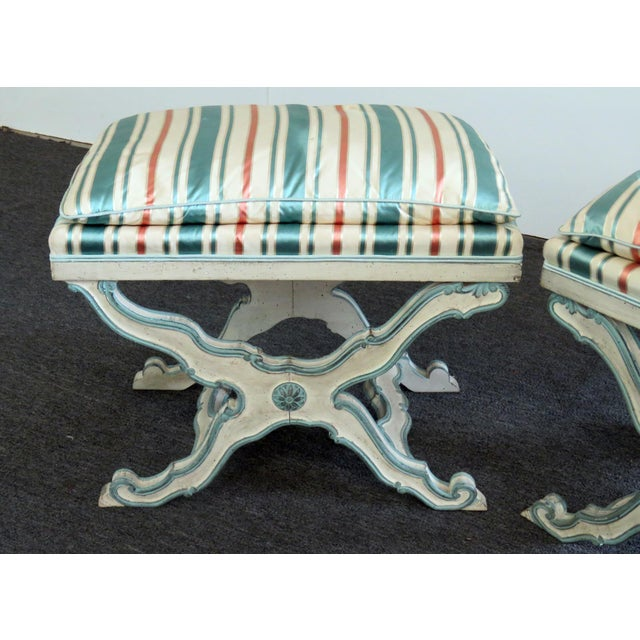 Pair of Swedish distressed paint decorated X benches.