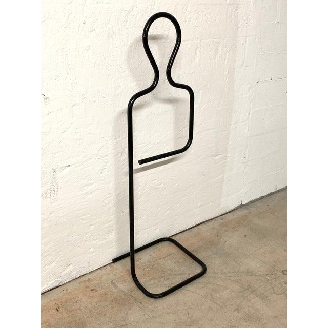 Figural and Sculptural valet, coat, or towel rack rendered in black powder coated tubular aluminum, designed by Pierre...