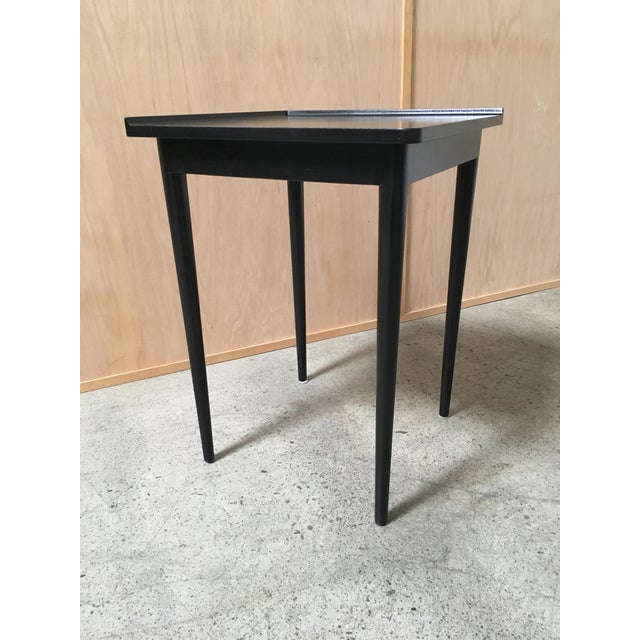 Ebonized corner table by Dunbar. Wear consistent with age and use