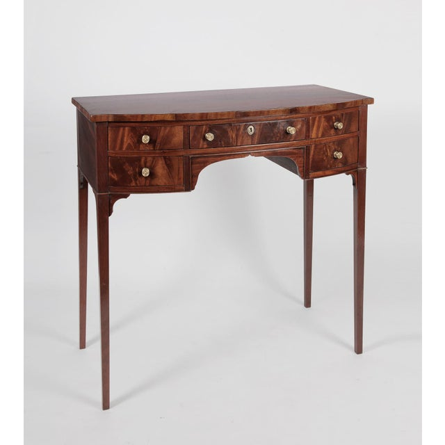 An antique English Regency bow front dressing table in the Sheraton style of the early 19th century, made of fine solid...