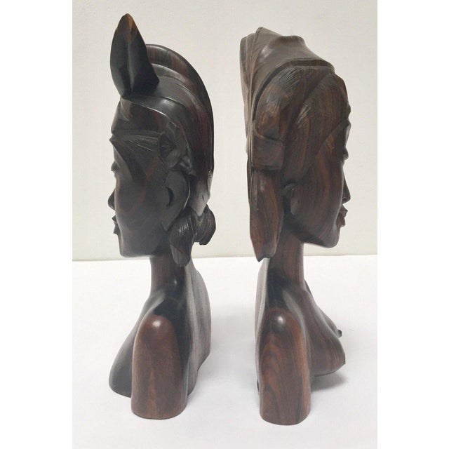 Vintage midcentury hand carved ebony wooden Balinese bookends. Hand carved sculpture in wood depicting a Balinese couple....