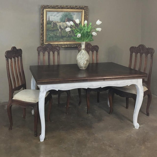Antique Country French Draw Leaf Painted/Stained Dining Table features beautifully carved oak with cabriole legs, parquet...